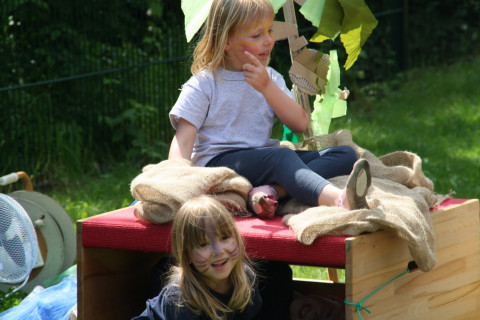 Chilren plying in the garden.