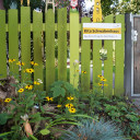 Gartenzaun mit Eingangsschild