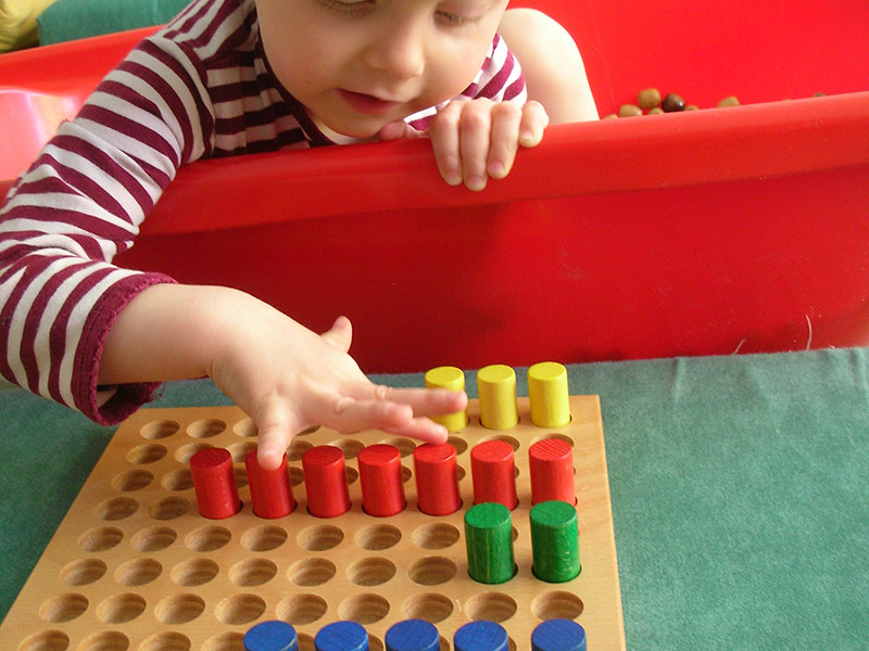 Boy with stacking game.